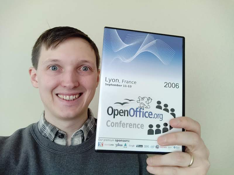 Georg holding up the OpenOffice.org DVD case that he designed